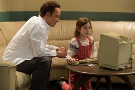 "In this image released by Universal Pictures, Michael Fassbender, left, as Steve Jobs and Makenzie Moss as a young Lisa Jobs, appear in a scene from the film, ""Steve Jobs."" The movie releases in the U.S. on Friday, Oct. 9, 2015. (Francois Duhamel/Universal Pictures via AP)"